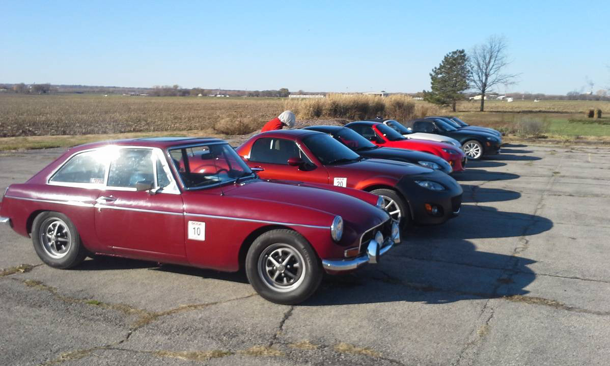 Old and New. MGB/GT to Miatas at the start.